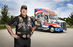 Schneider Receives 11th Ride of Pride Truck and Selects Navy Reserves Veteran as Its Captain