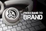 Custom die-cut band logo sticker on a pair of headphones